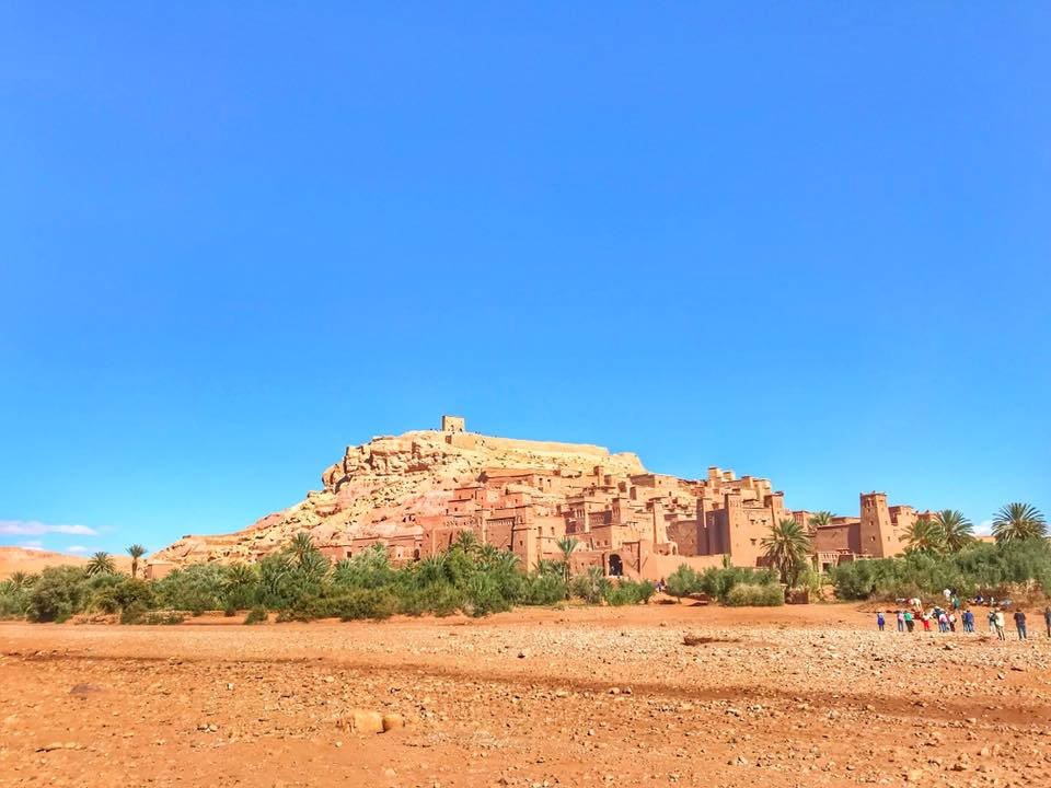 Visit Ait Ben Haddou kasbah to discover the traditional Moroccan architecture by wandering through it alleyways and meet the local still live there.